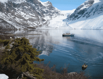 Ski touring from a boat in Greenland