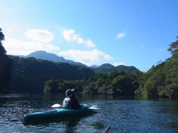 Kayaker with view on Anbo river in Yakushima