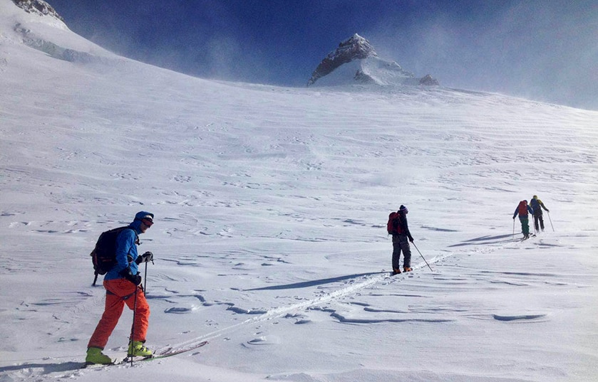 Romain and his friends ski touring in Monte Rosa range, Italy, guided by Andrea