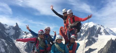 Women in the summit of a mountain